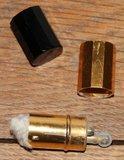 Oude brocante mini aansteker zwart met goud_