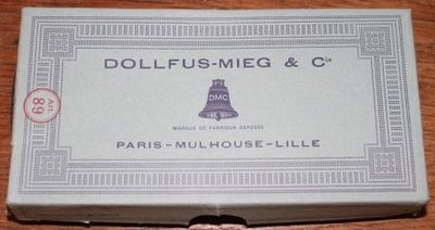 Blauw karton doosje + oranje DMC garen