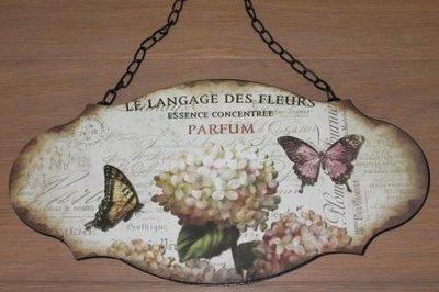 Brocante wandbord van metaal vlinders en bloem