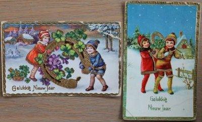Oude brocante kerstkaarten kindjes hoefijzer goud, 2 st.