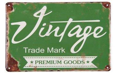 Brocante groen metalen wandbordje tekst Vintage Trade Mark